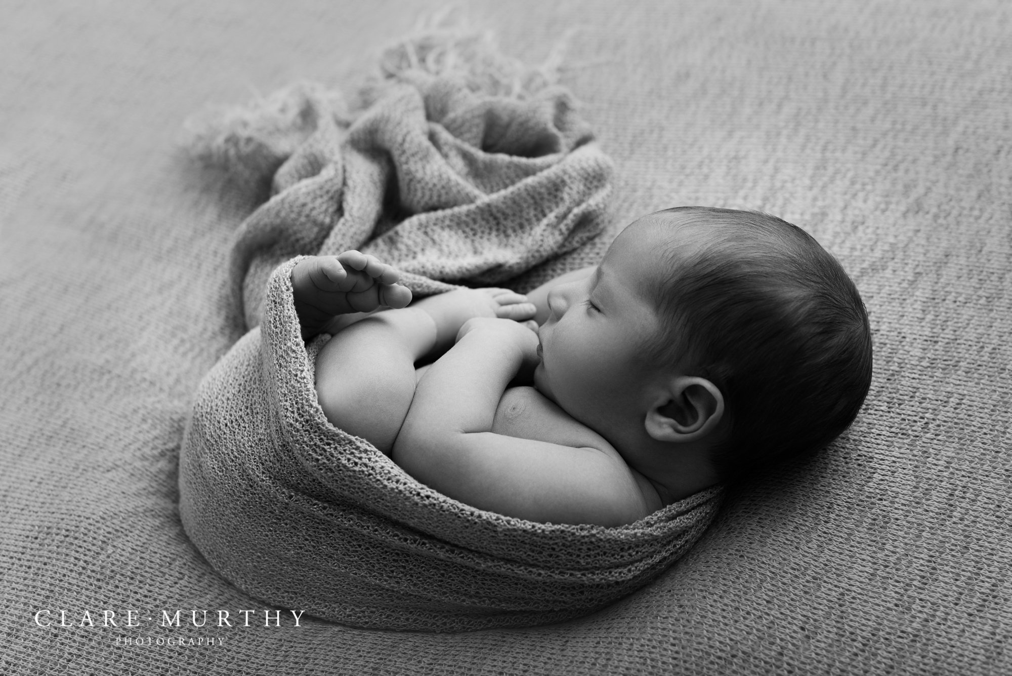 Wrapped up baby at newborn photo shoot in London